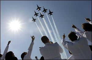 A formation of U.S. Navy Blue Angel fighter jets perform a flyover above graduating Midshipmen during the United States Naval Academy graduation and commissioning ceremonies May 29 in Annapolis, Md..