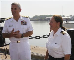 """A lot of people don't know what we do,"" said Rear Admiral Greg Nosal, left, commander of Carrier Strike Group 2 based in Norfolk, during a mid-July visit to Toledo to promote Navy Week. He appeared with Mary Dalby, owner/operator of the cruise vessel Sandpiper."