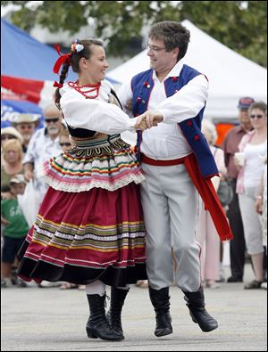 Location: Maria Szkudlarek, left, and Rob Szczublewski, Toledo, dance with other members of the Toledo group Echoes of Poland.