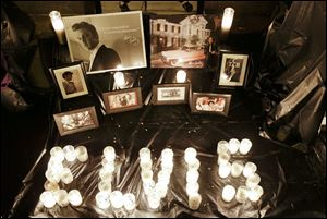A memorial marking the 35th anniversary of Elvis Presley's death is displayed outside of Graceland.