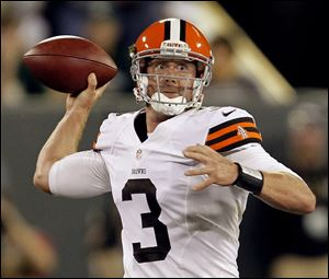 Cleveland Browns quarterback Brandon Weeden throws during the first half of a preseason NFL football game against the Green Bay Packers Thursday.