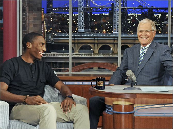 Kynard on Letterman Rogers grad and Olympic silver medalist, Erik Kynard, Jr., left, laughs it up with talk show host David Letterman on Thursday night.