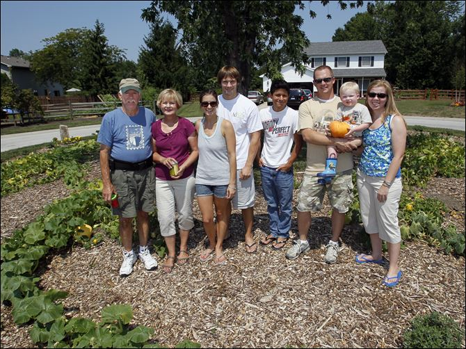 weed it residents From left: Jim and Joanne Bucklew, Meghan and Andy Yarnell, Sammy Irias, and Robert and Stephanie Hart with their son, Sawyer Hart.