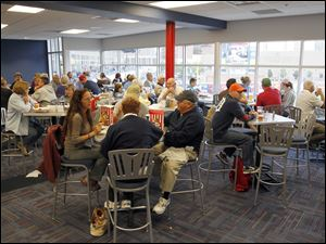 Patrons enjoy a meal at The Bird Cage restaurant at Fifth Third Field.