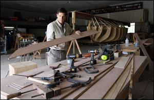 John Riddle works on the replica of the 19-foot pulling boat in which Commodore Oliver Hazard Perry was rowed to safety during the Battle of Lake Erie against the British fleet near Put-in-Bay, Ohio.