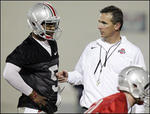 Urban Meyer, right, created his own spread offense in 2001 at Bowling Green, but the Ohio State coach has never been afraid of tweaking his own system.