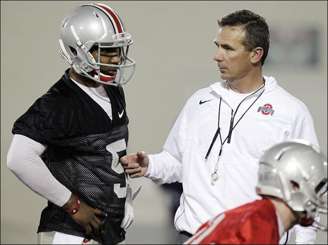Ohio St Spring Football-5 Urban Meyer, right, created his own spread offense in 2001 at Bowling Green, but the Ohio State coach has never been afraid of tweaking his own system.