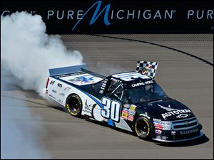 Nelson Piquet, Jr., won the Camping World Trucks series race at Michigan International Speedway on Saturday.