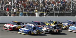 Greg Biffle, left, and Brad Keselowski lead the pack in the final laps at MIS. Biffle sprinted away in the end to win.