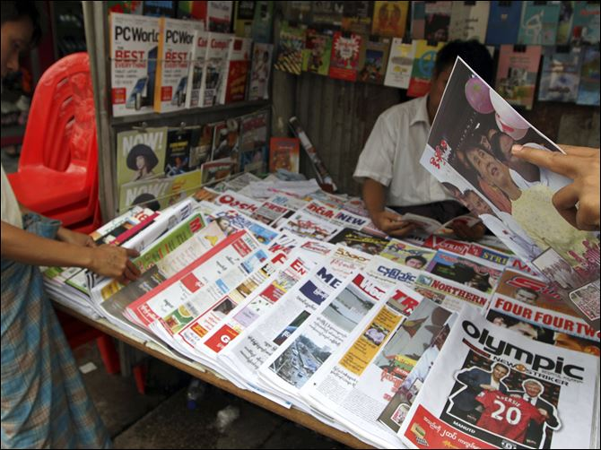 Myanmar Easing Censorship Customers buy local weekly journals at a roadside shop in Yangon, Myanmar. Myanmar's government said Monday it was abolishing the harsh practice of directly censoring the country's media.