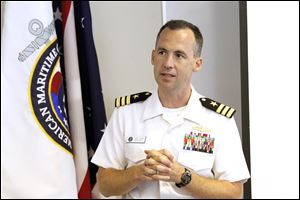 Cmdr. Josh Himes speaks to students from the Maritime Academy about Navy Week events. He complimented the academy's efforts.