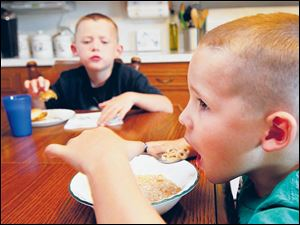 Ethan, 5, right, is allergic to peanuts and isn't allowed to eat at anyone else's home. He also only eats his own lunch at school.