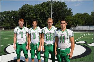 Ottawa Hills captains, from left, Cole Ferguson, Jonathan Rodriguez, Matt Knetchel-Bernath, and Will Longthorne.