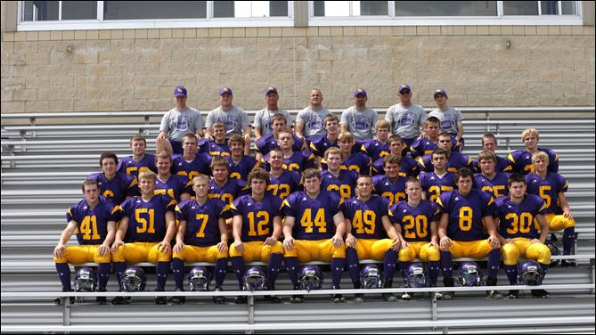 SPT Blissfieldf FOOTBALL FROM LEFT: Row 1: Austin Bates, Jason Slomski, Isaiah Rupp, Jordan Willson, Zech Bostick, Christopher Bausman, David Wolfe, Lee Keinath, Robert Hunt Row 2: Nate Wold, Alex Waggoner, Jacob Bayer, Grayson Strouse, Dylan Thompson, Brad Lietzke, Grant Mitchell, Austin Waggoner, Jacob Ford Row 3: Stone MacBeth, Dakota Suiter, Luke Cassaubon, Tyler Clark, Chris Barrus, James Foley, Tyler Watters, Skyler Miller, Jacob Bayer Row 4: Joey Wright, Dakota Underwood, Christian Waynick, Daniel Barta, Garrett LaRoy Row 5: Coaches - Josh Andrews, Andy Ford, head coach Ron Estes, Matt Garno, John Garno, Denny Thompson and manager Phil Kerbawy