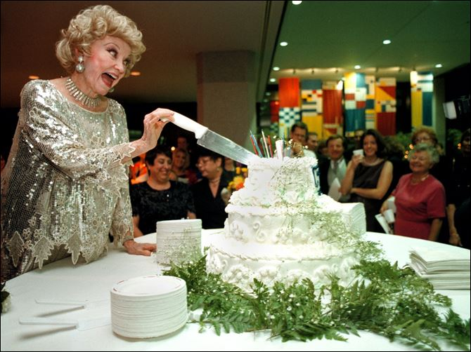 Phyllis Diller cuts the cake during the Goodwill Industries Phyllis Diller cuts the cake during the Goodwill Industries of Northwest Ohio's 65th birthday in 1998 in Toledo. She introduced herself as the 'Madonna of the Geritol Set.'