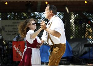 Dawn Krupinsky, left, and her husband Walter Krupinsky of St. Clair Shores, Mich., dance a polka.