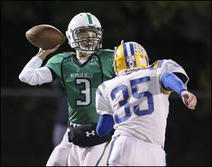 Quarterback Jon Rodriguez, left, threw for 1,141 yards and 16 touchdowns last season for Ottawa Hills.