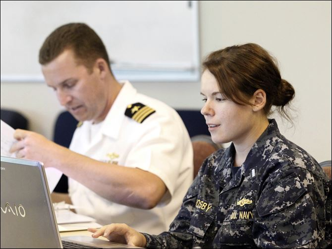 Cmdr. Jamie Achee Cmdr. Jamie Achee and Lt. j.g. Tiffany Crosby work at the Command Center at One Maritime Plaza in preparation for Navy Week. Ships are to arrive Thursday and be open for tours Friday to Sunday.