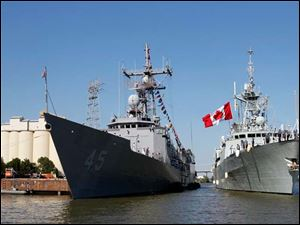 The HMCS Vile de Quebec, right, ties up along side the USS De Wert at One Maritime Plaza in downtown Toledo.