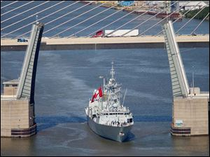 The Canadian frigate HMCS Ville de Quebec,  passes through the Craig Bridge over the Maumee River as it heads toward downtown Toledo.