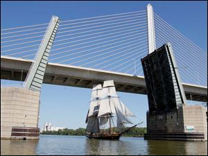 The Brig Niagara heads under the Veteran's Glass City Skyway Bridge.