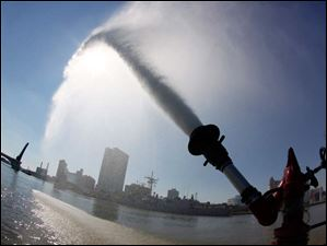 Water shoots from a canon on the Toledo Fire and Rescue Department's Marine 1.
