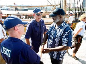 Left to right USCG Chief Warrant Officers Mike Mitchell and Greg Miller greet Mayor Mike Bell near the U.S. Brig Niagara.