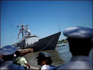 Spectators watch as the USS De Wert docks along the Maumee River Thursday.