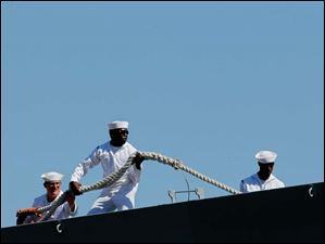 Sailors on the USS De Wert help dock at One Maritime Plaza.