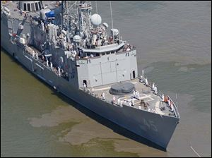 Sailors line the deck of the frigate USS De Wert on the Maumee River.
