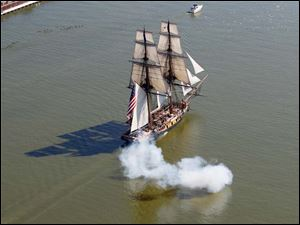 The U.S. Brig Niagara fires its canon as it arrives on the Maumee Riverr.  The ship is here for Navy Week events commemorating the bicentennial of the War of 1812.