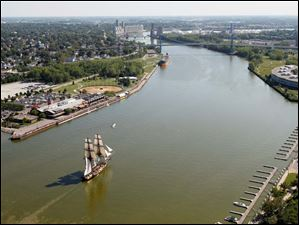 The  U.S. Brig Niagara makes its way up the Maumee River toward International Park.