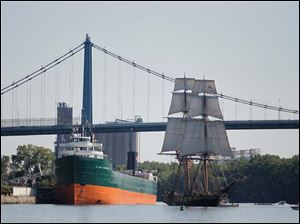 The U.S. Brig Niagara prepares to dock near the Col. James M Schoonmaker.