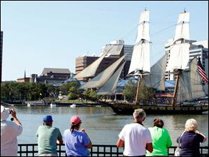 Spectators watch as the U.S. Brig Niagara pulls into Toledo. The ship was part of the battle on Lake Erie in the War of 1812.