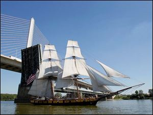 The U.S. Brig Niagara heads under the Veteran's Glass City Skyway Briege and up the Maumee River.