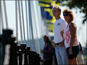 Chris and Mimi Baxtor of Rising Sun, Ohio, watch from Promenade Park as the U.S. Coast Guard Cutter Mobile Bay travels down the Maumee River.
