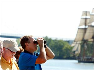 Spectators at International Park try to get a better look at the naval ships as they pull into downtown Toledo Thursday.
