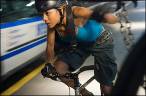 Dania Ramirez plays Vanessa in a scene from 'Premium Rush.'