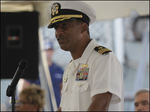 Cdr. Joseph C. Thomas welcomes the guests.