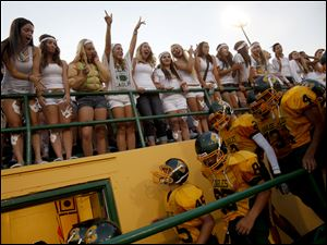 Fans cheer for the Clay High School varsity football team as they make their way into the locker room for halftime during their game against Northview High School.