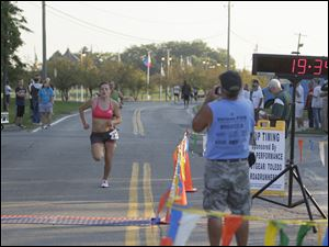 "U.S. Army Specialist Patti Swayka, of Wisconsin, is the first woman to cross the finish line in the ""Heroes in Action"" 5K race."