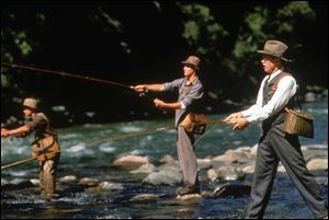 "Actors Brad Pitt, from left, Craig Sheffer, and Tom Skeritt fish in a scene from ""A River Runs Through It."""
