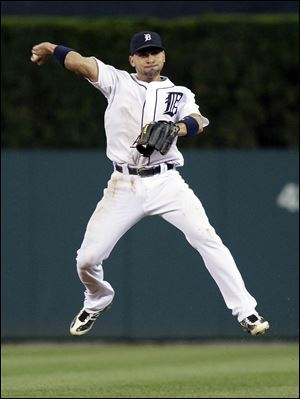 Tigers second baseman Omar Infante makes a leaping throw to first base to get out the Angels' Kendrys Morales on a ground ball in the eighth inning.