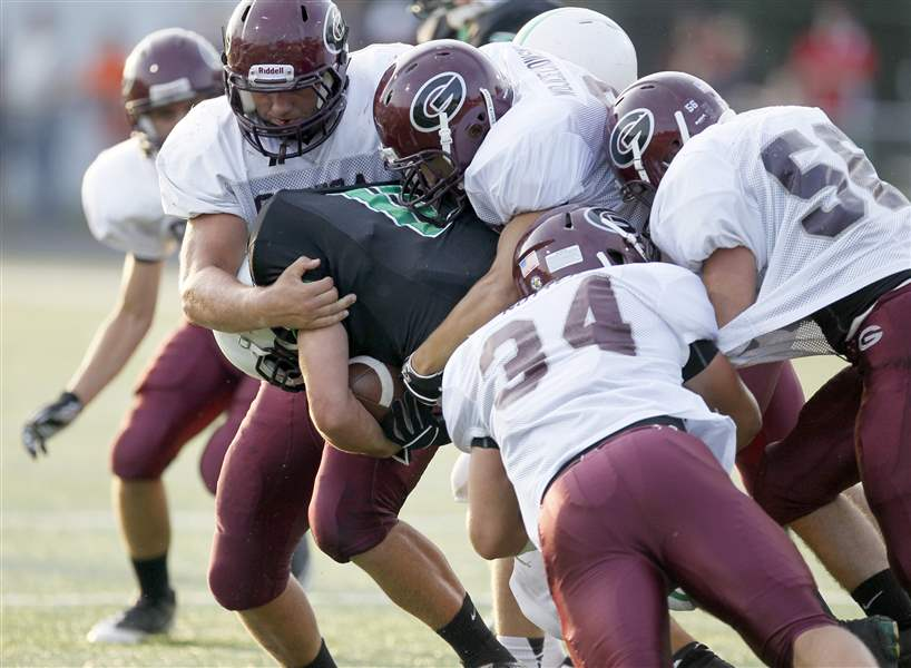 Genoa-football-defense-tackles-Ottawa-Hills-Will-Longthorne