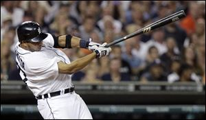 Detroit Tigers' Jhonny Peralta hits a double in the eighth inning to drive in Prince Fielder and Andy Dirks against the Los Angeles Angels in a baseball game Saturday.