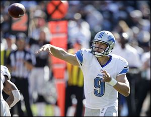 Lions quarterback Matthew Stafford has his hand in a cast after being injured in Saturday night's game.