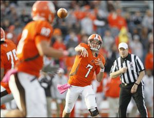 Bowling Green State University quarterback Matt Schilz, 7, throws a pass last season. This season, measuring the junior signal-callers improvement will be a more subtle thing. He may throw for fewer yards, and he may collect fewer touchdowns, but that doesn't necessarily mean he hasn't improved.