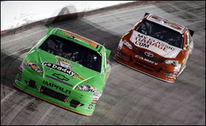 Danica Patrick (10) drives in front of Brian Vickers (55) during the NASCAR Sprint Cup Series auto race .