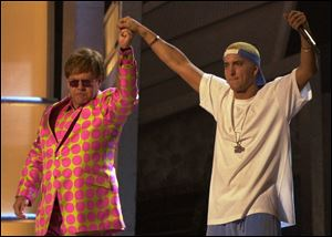 Elton John, left, and Eminem appear together after performing a duet near the end of the 43rd annual Grammy Awards in 2001 at the Staples Center in Los Angeles. Anti-gay sentiments have been entrenched in hip-hop for decades. Eminem, widely known for offensive lyrics toward homosexuals, has joined Jay-Z in saying people of the same-sex should be able to love one another.