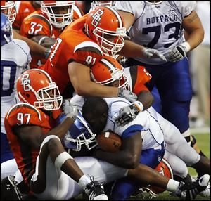 Bowling Green State University defender Darius Smith, top center, makes a stop last season. Scouts are intrigued by a guy who is 6-foot-1, but seems taller; who is 293 pounds, but seems lighter; who plays defensive tackle, but more like a very mobile, agile end.